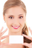 Happy girl with business card — Stock Photo