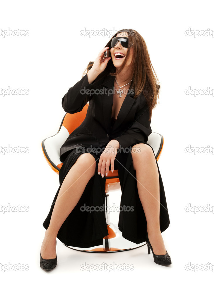 Businesswoman with phone in orange chair over white  Stock Photo #11770578