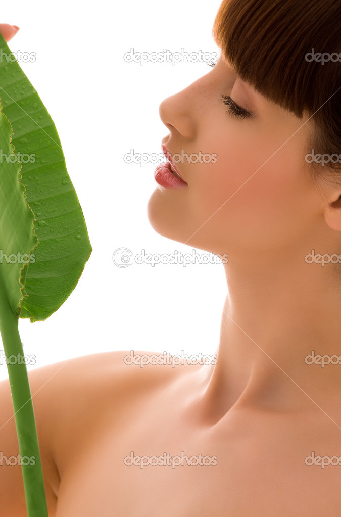Picture of woman with green leaf over white — Stock Photo #11773255