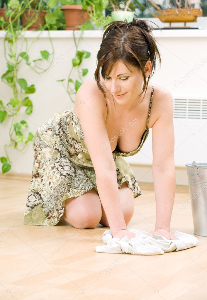 Bright picture of lovely housewife cleaning floor  Stock Photo #11773382