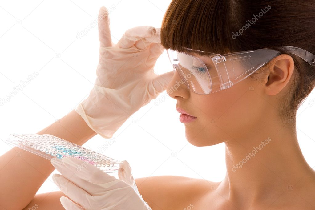 Closeup of beautiful lab worker holding up reagents — Stock Photo #11773516