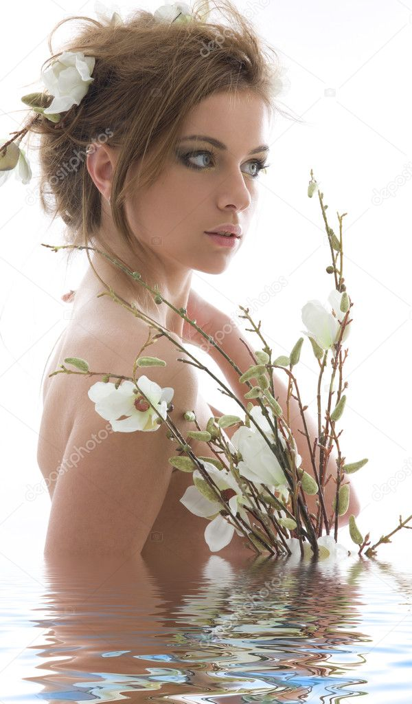 Picture of lovely woman with white flowers — Stockfoto #11773858