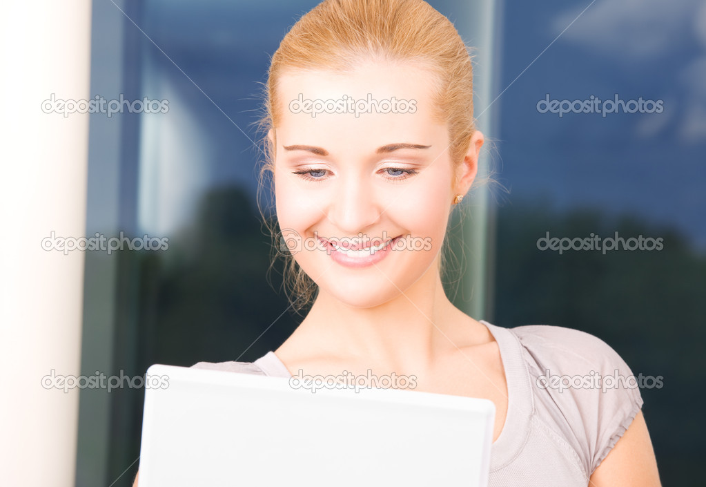 Picture of happy businesswoman with laptop computer — Stock Photo #11774215