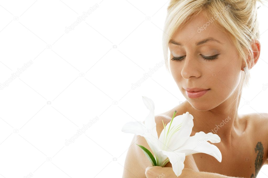 Pretty lady with madonna lily over white background — Stock Photo #11774670