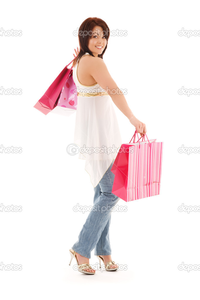 Happy woman with pink shopping bags over white — Stock Photo #11775237