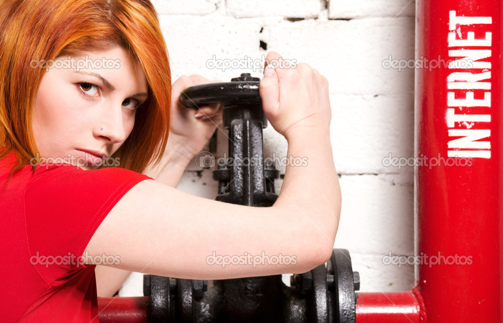 Picture of redhead woman with internet access valve — Stock Photo #11775982