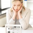 Pensive businesswoman with sand glass — Stock Photo #11839675