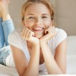 Smiling teenage girl on a bed — Stock Photo #11839755