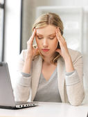 Tired woman with laptop computer — Stock Photo
