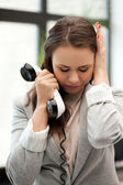 Sad businesswoman with phone — Stock Photo