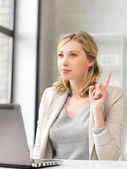 Woman with laptop and finger up — Stock Photo