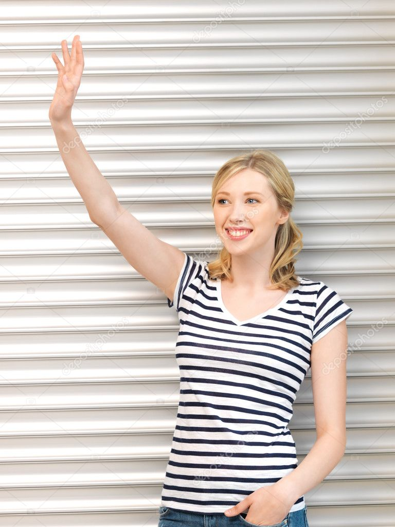 Picture of happy teenage girl waving a greeting — Stock Photo #11839820