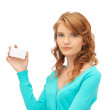Attractive student with business card — Stock Photo