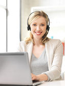 Helpline operator with laptop computer — Stock Photo