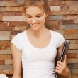 Happy and smiling teenage girl with big notepad — Stock Photo #11943364