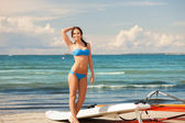 Happy woman with wind surf on the beach — Stock Photo
