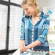 Stock Photo: Lovely housewife with iron