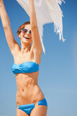 Happy woman with white sarong on the beach — Stock Photo