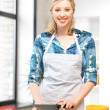 Stock Photo: Beautiful woman in the kitchen
