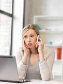 Businesswoman with cell phone — Stock Photo