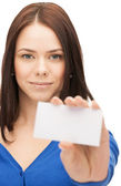 Attractive businesswoman with business card — Stock Photo