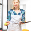 Beautiful woman in the kitchen — Stock Photo #12107248