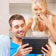 Happy couple with tablet pc computer — Stock Photo #12136034