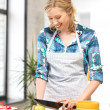 Beautiful woman in the kitchen — Stock Photo #12136056
