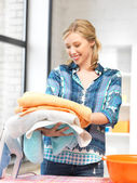 Lovely housewife with towels — Stock Photo