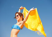 Happy woman with yellow sarong on the beach — Stock Photo