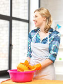 Housewife washing dish at the kitchen — Stock Photo