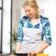 Beautiful woman in the kitchen — Stock Photo #12171931