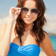 Stock fotografie: Happy womin sunglasses on beach
