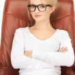 Stock Photo: Businesswomsitting in chair