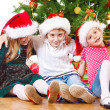 Beside Christmas tree — Stock Photo #11628597