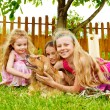 Kids  playing with dog — Stock Photo