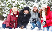 Cheerful girls on snow — Stock Photo