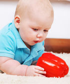 Infant with red pepper — Stock Photo