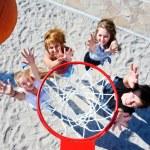 Basketball hoop and teenagers — Stock Photo #11630148
