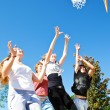 Teenagers playing basketball - Stock Photo