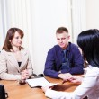 Customers discussing contract - Stock Photo
