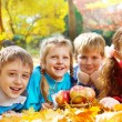 Kids group in autumn park — Stock Photo