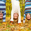 Kids upside down - Stock Photo