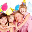 Family in party hats — Stock Photo