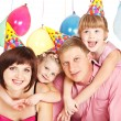 Family in party hats - Stock Photo