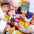 Kids in scarves and hats - Stock Photo