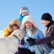 Family playing with dog — Stock Photo