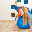 Girl playing with gymnastic ball — Stock Photo