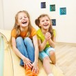 Girls sit on tumbling mats - Stock Photo