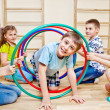 Playing in school gym — Stockfoto